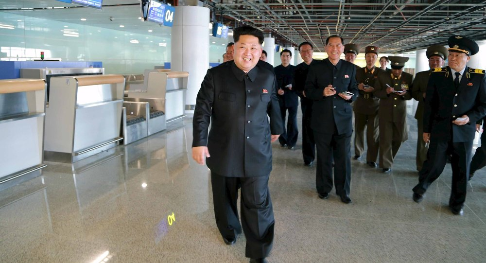 North Korean leader Kim Jong Un (front) smiles as he gives field guidance at the construction site of Terminal 2 of Pyongyang International Airport