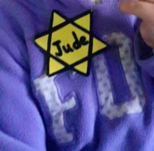 A Israeli mother posted to Facebook this picture of an her child, a kindergarten student, wearing a yellow Star of David.