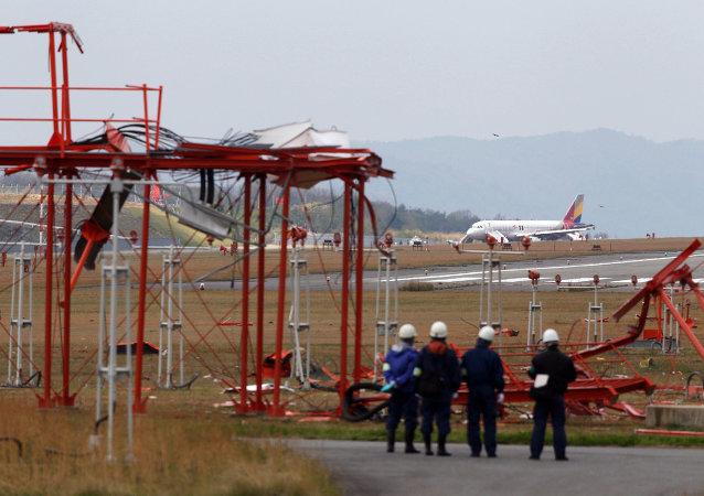 Officials check broken localiser facilities at the Hiroshima airport in Mihara in Hiroshima