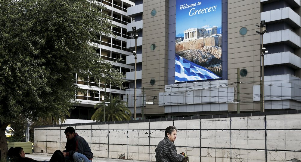 People are seen on Omonia square in Athens