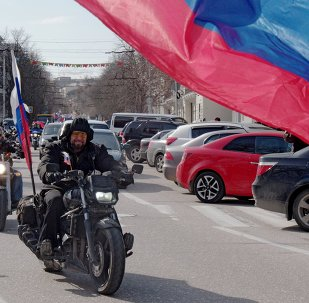 President of the All-Russian Motorcycle Club Night Wolves Alexander Zaldostanov, center, during a motor rally called Russian Spring Roads timed to coincide with the first anniversary of Crimea's reunification with Russia, in Sevastopol.