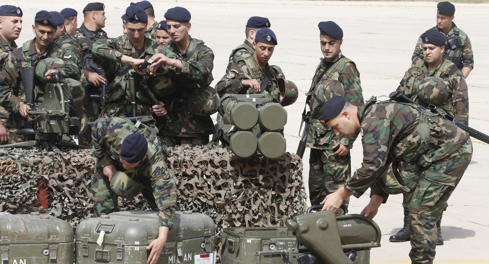 Lebanese army soldiers pack weapons that they received during a ceremony at Beirut airport airbase April 20, 2015
