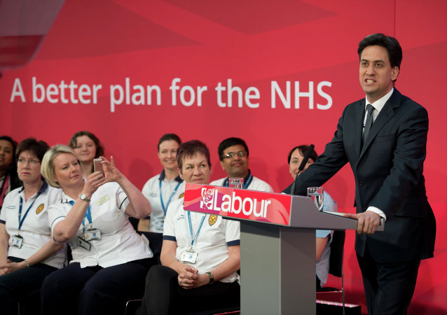Ed Miliband, the leader of the opposition Labour Party, addresses an audience in the Brooks Building of Manchester Metropolitan University on the subject of healthcare in Manchester, northwest England on April 21, 2015