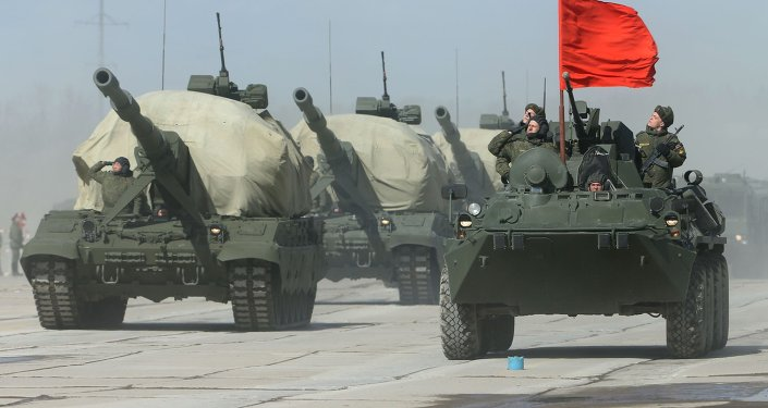 Self-propelled artillery system Koalitsiya-SV (L) and BTR-82A (R) armoured personnel carrier at the May 9 Victory Parade rehearsal in Moscow region.