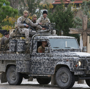 Lebanese army special forces patrol near the area militants ambushed Lebanese soldiers, in Ras Baalbek town, eastern Lebanon, Wednesday, Dec. 3, 2014