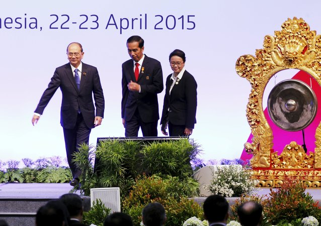 Myanmar's President Thein Sein, Indonesia's President Joko Widodo, and Indonesian Minister of Foreign Affairs Retno Marsudi walks after the opening ceremony of the Asian African Conference