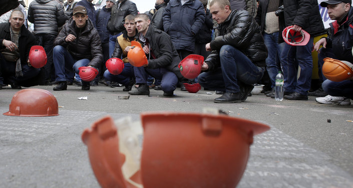 Ukrainian coal miners protest outside the president's office in Kiev