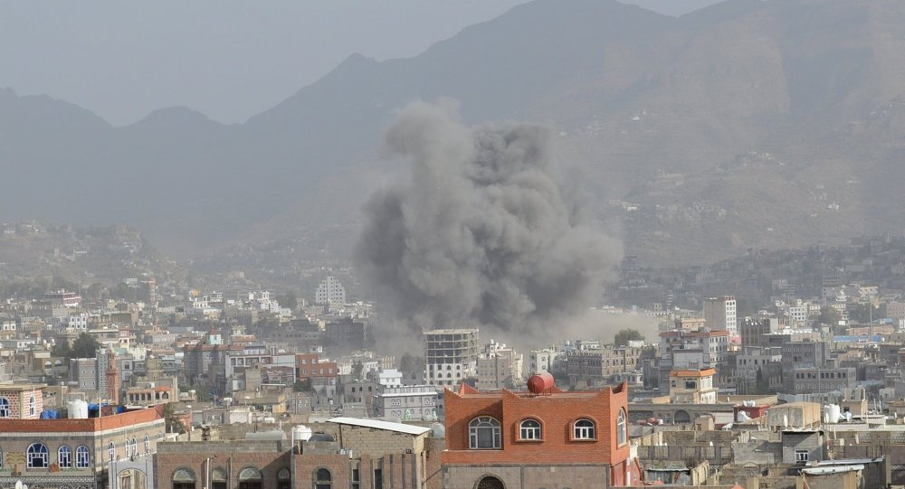 Smoke billows after an air strike in Yemen's central city of Ibb April 12, 2015