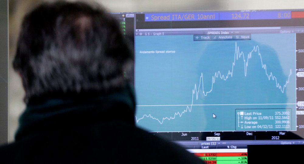 A man watches a monitor showing graphic of spread performance between Italian and German bonds, in Milan, Italy, Thursday, Jan. 15, 2015