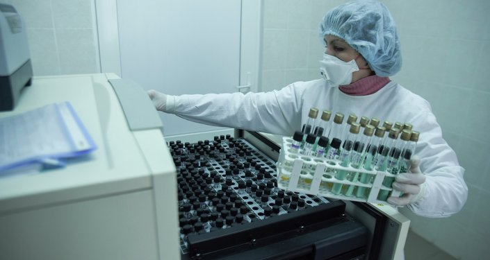 A researcher prepares samples for testing at a laboratory.