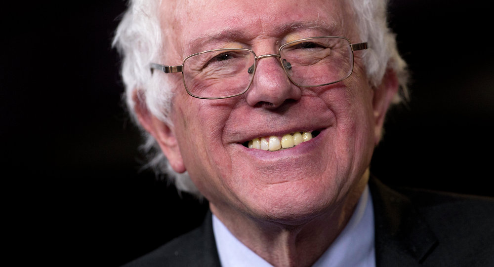 Sen. Bernie Sanders, I-Vt., smiles as he is asked about running for president during a news conference on Capitol Hill in Washington, Wednesday