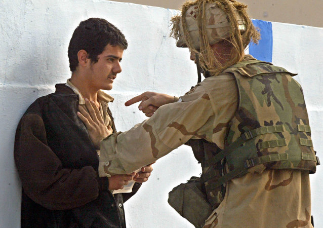 A US soldier from Charlie Company, 1st Battalion, 22nd Regiment, (1-22) of the 4th Infantry Division explains to Iraqi man his mistake after he verbally demonstrated his negative attitude to the US army while on a patrol of Tikrit, Iraq, Thursday, Dec. 18, 2003