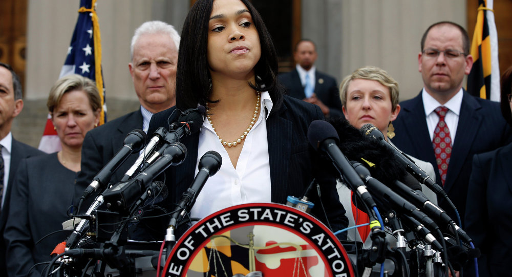 Marilyn Mosby, Baltimore state's attorney, pauses while announcing charges against the six officers involved in Gray's arrest, on Friday, May 1, 2015 in Baltimore.