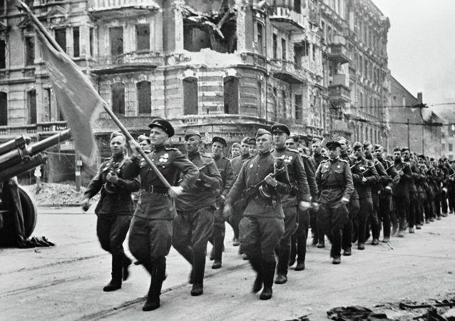 Soviet soldiers marching at the May 1 parade in Berlin
