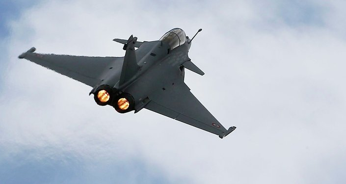 A Rafale fighter jet flies over the factory of French aircraft manufacturer Dassault Aviation in Merignac near Bordeaux, France, in this March 4, 2015 file photo