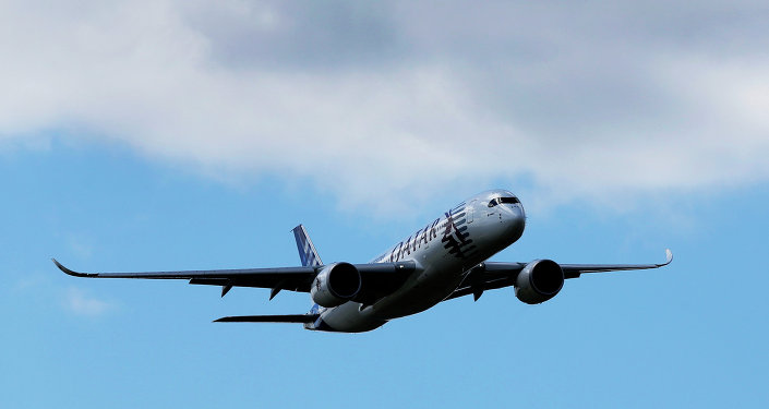 An Airbus A350 XWB flies on display during the Farnborough International Air Show, Farnborough, England, Monday, July 14, 2014.