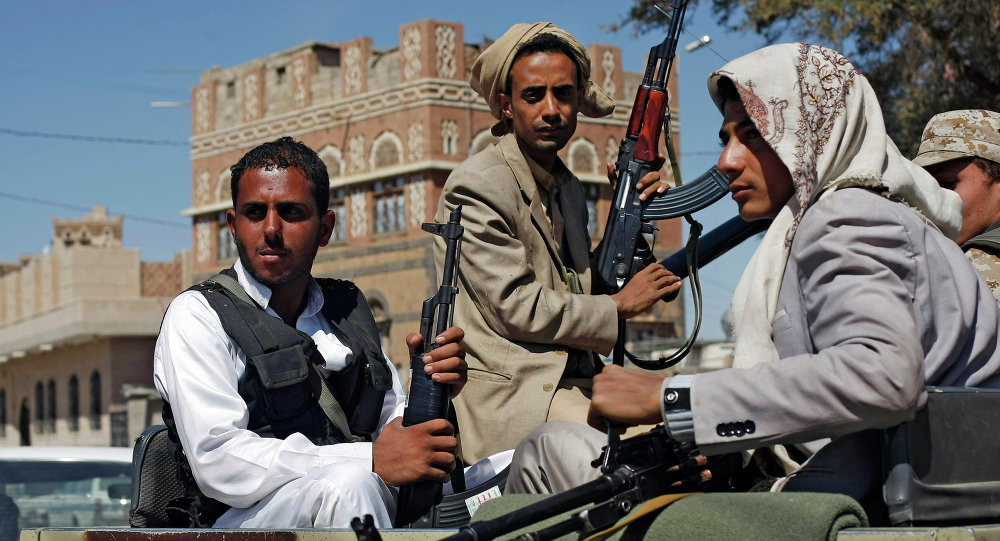 Houthi Shiite rebels ride in a military truck while patrolling a street in Sanaa, Yemen