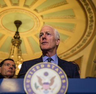 Senate Majority Whip John Cornyn of Texas, accompanied by Sen. John Barrasso, R-Wyo., and Senate Majority Leader Mitch McConnell,of Ky., speaks to reporters on Capitol Hill in Washington