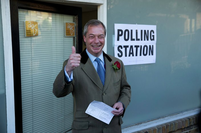 Nigel Farage the leader of the UK Independence Party (UKIP) poses for photographers as he arrives to cast his vote at a polling station in Ramsgate, south east England, Thursday, May 7, 2015.