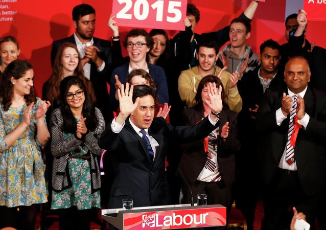 Britain's opposition Labour Party leader Ed Miliband waves at a campaign event in Colne, northern England, Britain, May 6, 2015