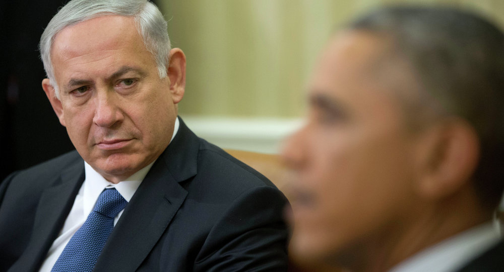 Israeli Prime Minister Benjamin Netanyahu listens as President Barack Obama speaks during their meeting in the Oval Office of the White House in Washington, Wednesday, Oct. 1, 2014.