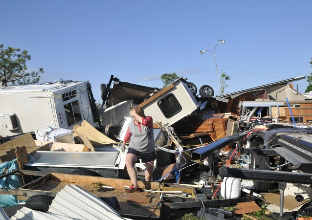Sharon Odom looks over what is left of her RV at the Roadrunner RV Park in Oklahoma City, Oklahoma May 7, 2015