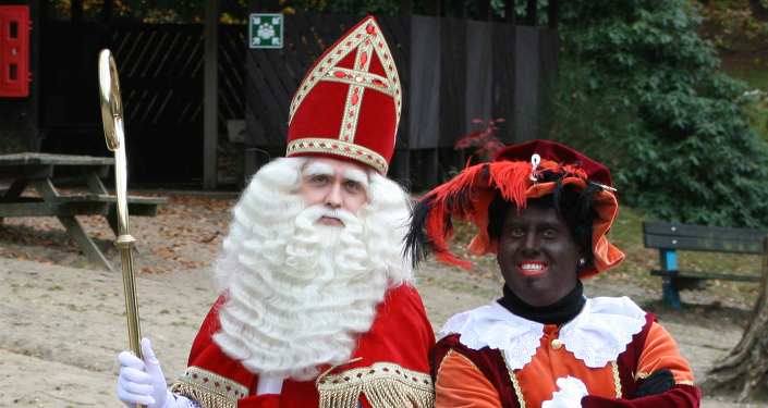 In the Netherlands, black-faced helpers called Zwarte Piet (Black Pete) assist Santa Claus. The custom has been condemned as racist for its use of blackface.