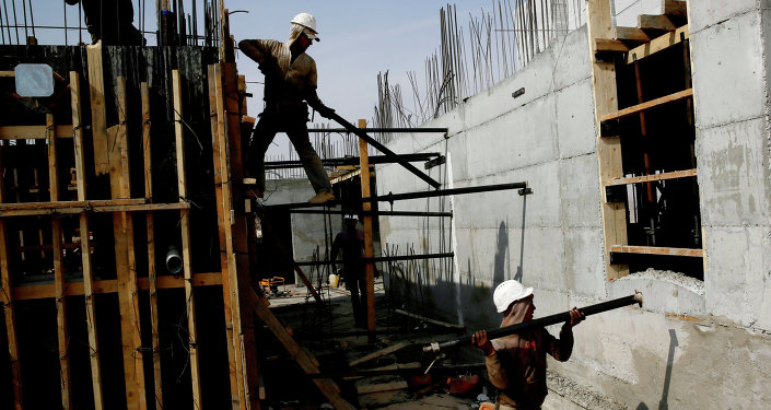 Palestinian laborers work on a construction site in Ramat Shlomo, a Jewish settlement in the mainly Palestinian eastern sector of Jerusalem, on October 30, 2013
