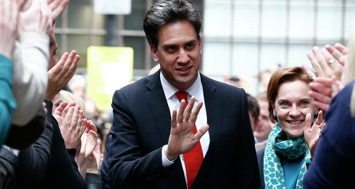 Opposition Labour party leader Ed Miliband (C) and his wife Justine Thornton arrive at Labour party headquarters in London on May 8, 2015, the day after a general election