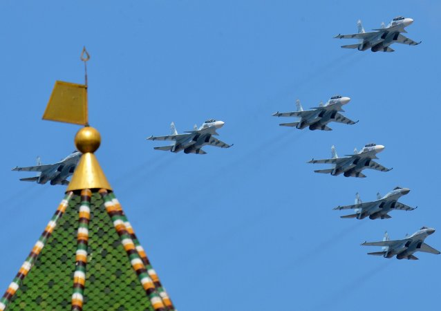 Sukhoi Su-30SM Flanker-C and Su-35S Super-Flanker fighters fly by during rehearsal for parade