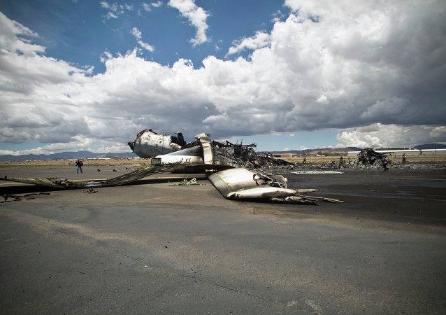 The wreckage of a military transport aircraft destroyed by Saudi-led airstrikes, at the Sanaa International airport, in Yemen