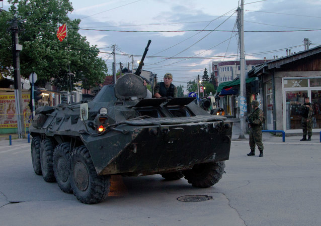 Macedonian special police unit leave the area were a battle took place involving the police and an armed group, in northern Macedonian town of Kumanovo