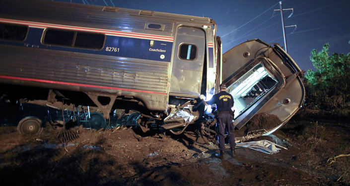 Emergency personnel work the scene of a deadly train wreck, Tuesday, May 12, 2015, in Philadelphia