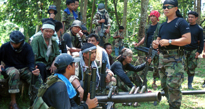 Abu Sayyaf spokesman Abu Sabaya, right foreground, is seen with his band of armed extremists in this undated photo