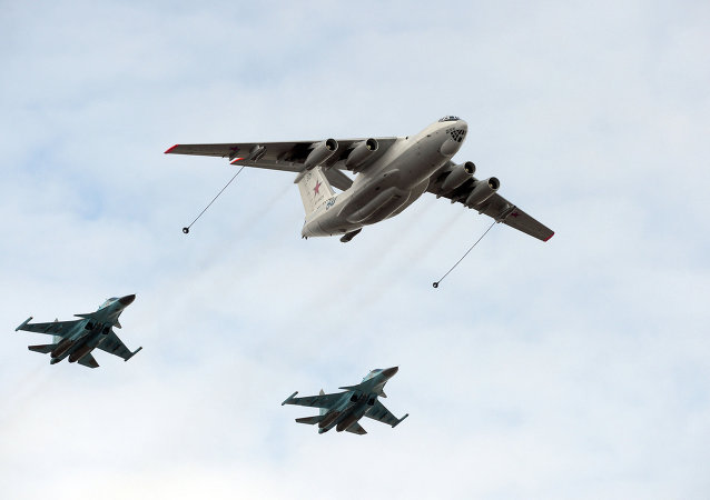 An Il-78 tanker aircraft and Sukhoi 34 assault fighter bombers during a joint training of soldier formations and mechanized units for the Victory Parade