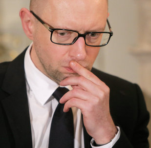Ukrainian Prime Minister Arseniy Yatsenyuk talks with reporters during an interview with the Associated Press in Kiev, Ukraine, Friday, March 27, 2015