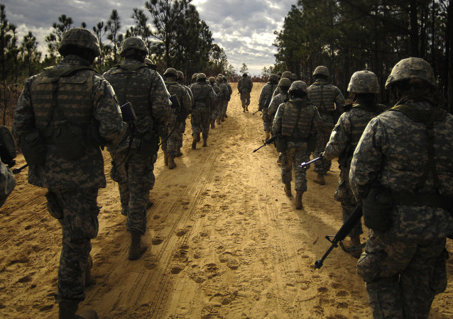 US Army recruits practice patrol tactics while marching during U.S. Army basic training at Fort Jackson