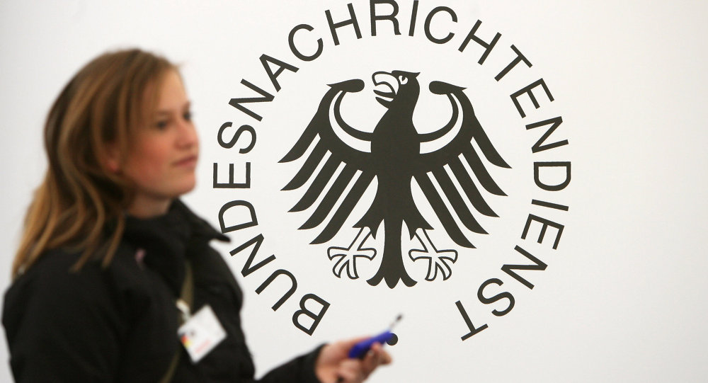 A guest walks past a logo of Germany's intelligence agency the Bundesnachrichtendienst (BND - Federal Intelligence Service)