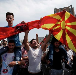 Anti-government protesters wave Albanian and Macedonian flags during a demonstration in Skopje, Macedonia, May 17, 2015