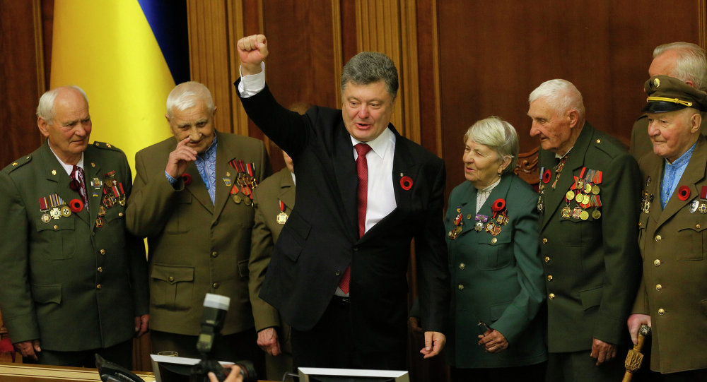 Ukrainian President Petro Poroshenko gestures as he stands alongside WWII veterans of the Ukrainian Insurgent Army during a special session of parliament in Kiev, Ukraine, Friday, May 8, 2015