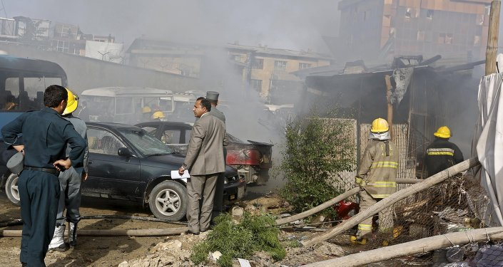 Afghan security forces investigate the site of a bomb blast in Kabul, May 19, 2015