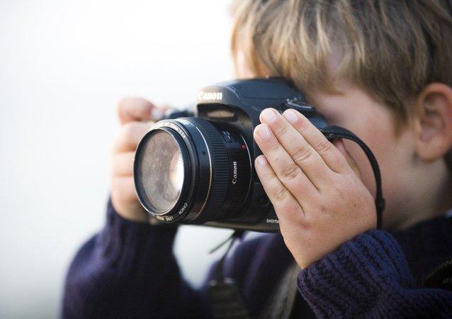 A boy with camera