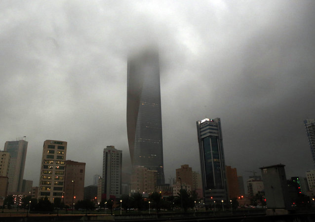 Clouds cover buildings in Kuwait City during a heavy rainfall