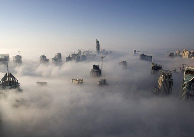 Heavy fog rolls by early in the morning near the Dubai Marina, United Arab Emirates.