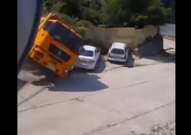 Man Narrowly Escapes Truck Crash