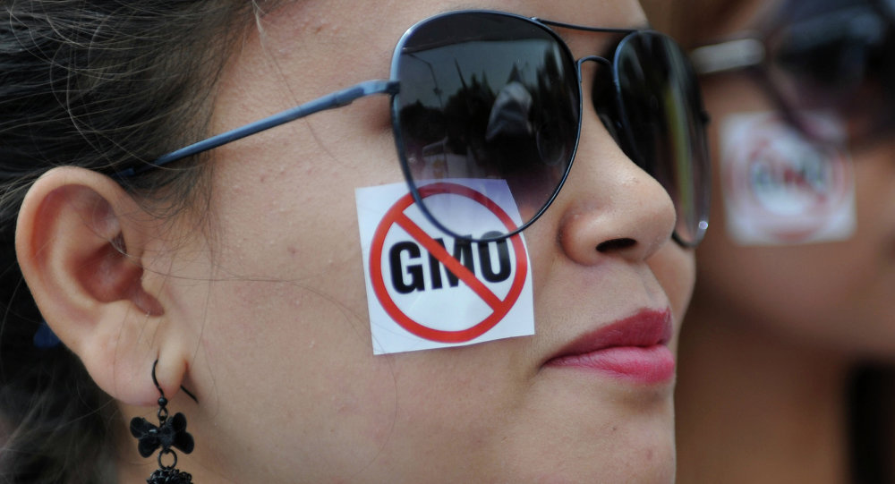 Greenpeace activists take part in a protest march against Monsanto in Bangalore on May 24, 2014