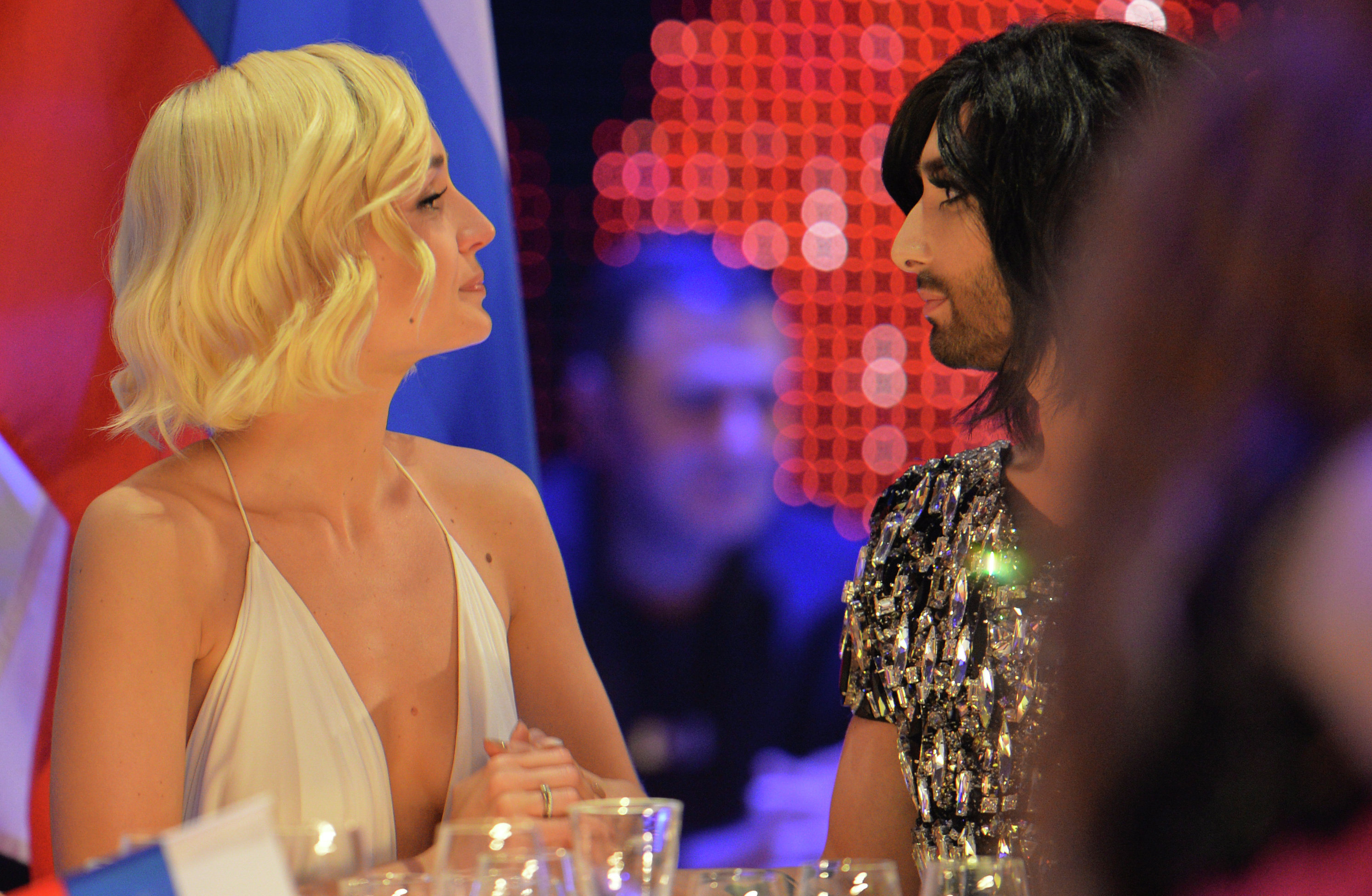 Conchita Wurst, who won the 2014 ESC for Austria, right, talks to Polina Gagarina representing Russia during the final of the Eurovision Song Contest in Austria's capital Vienna, Sunday, May 24, 2015