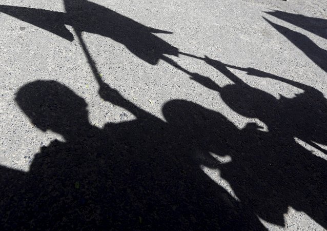 Shadows of children are reflected on the ground as they participate in an anti-Saudi protest outside the United Nations headquarters in Sanaa May 14, 2015