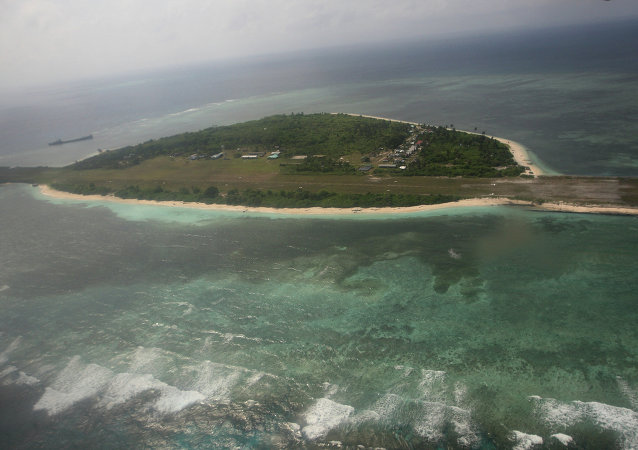 An aerial photo shows Thitu Island, part of the disputed Spratly group of islands, in the South China Sea located off the coast of western Philippines on July 20, 2011