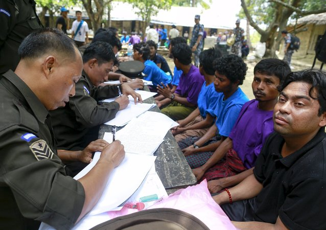 Rohingya Muslims from Myanmar, who were rescued by the Myanmar navy alongside Bangladesh refugees, are interviewed by immigration officers at a Muslim religious school used as a temporary refugee camp, at the Aletankyaw village in the Maungdaw township, in Rakhine state May 23, 2015
